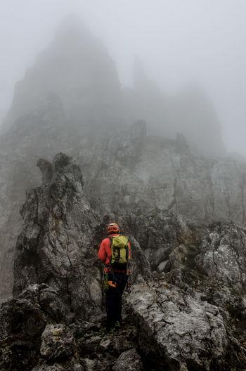 Alpinism Backpack Cliff Climbing Fog Foggy Kopftörl Kopftörlgrat Landscape Mountain Ridge Rock Formation Snow Unrecognizable Person Wilder Kaiser Kaisergebirge Ellmauer Halt Climbing A Mountain Mysterious Looking Up Challenge Low Angle View