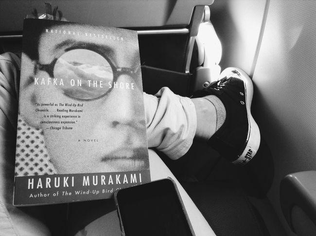 Haruki Murakami Book In The Airplane Blackandwhite