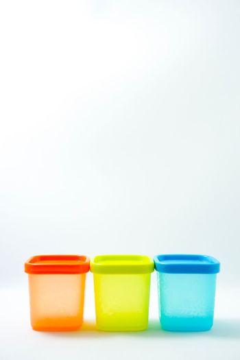 Close-up of colorful stack against white background