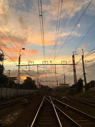 railway Sky Sunset Cloud - Sky Nature Cable Transportation Visual Creativity No People vanishing point Power Line  Railroad Track Track Direction Rail Transportation Outdoors Diminishing Perspective Connection The Way Forward Electricity  Technology