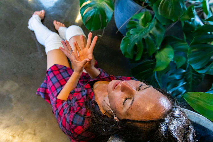 High angle view of woman lying down outdoors