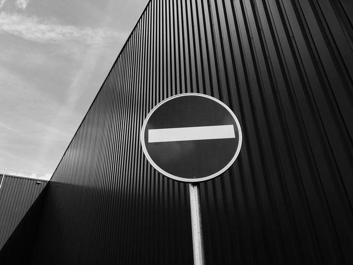 Streetphotography Sign Built Structure Architecture No People Sky Day Communication Geometric Shape Outdoors Circle Road Sign Metal Nature Road Shape Pattern Cloud - Sky City Low Angle View Building Exterior