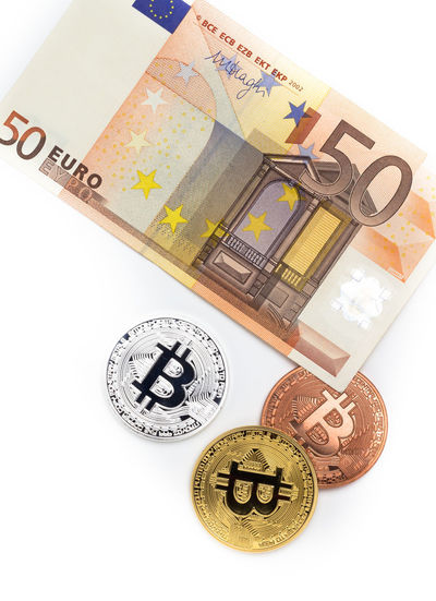 Financial concept with image of bitcoins on fifty euro banknote. Traditional money versus cryptocurrency concept. Business Currency EUR Economy Electronic Background Bank Banking Banknote Bill Bills Bitcoin Blockchain Buy Cash Coin Concept Crypto Cryptocurrency Cryptography Digital Euro Europe Exchange Fifty