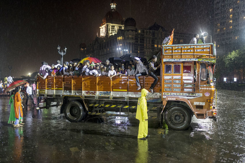 Monsoon weather sweeps into Mumbai on the final evening of the Ganesh Chaturthi festival. Dark Evening Extreme Weather India Monsoon Mumbai Night Outdoors Outdoors Photograpghy  People Rain Raining Transportation Travel Travel Photography Truck Umbrellas