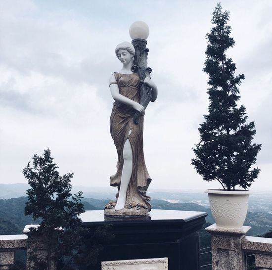 Lady Statue Sculpture Human Representation Art And Craft Male Likeness Sky Creativity Tree Pedestal Low Angle View No People Outdoors Day Fine Art Statue Nature EyeEmNewHere