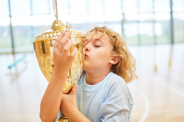 Boy kissing trophy
