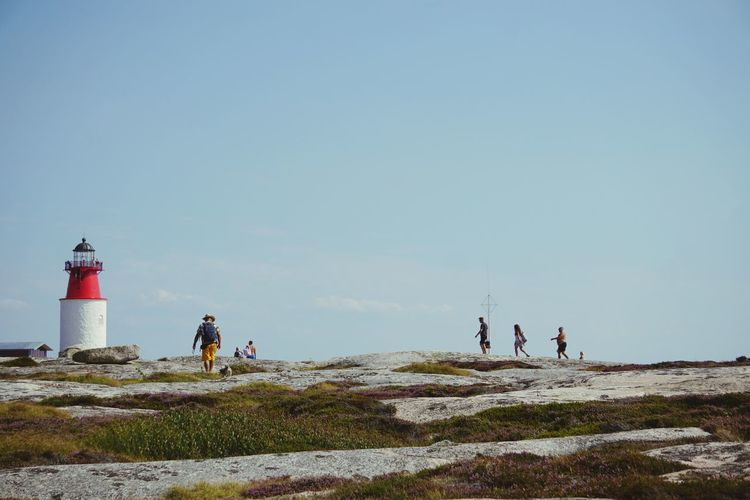 people walking on the rocks Sand Dune Sea Lighthouse Beach Clear Sky Togetherness Full Length Standing Water Sky Rocky Mountains Countryside Hiking Rock Formation Shore Seascape Scenics Hiker Coast Geology Eroded Coastline The Still Life Photographer - 2018 EyeEm Awards