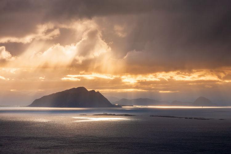 Sunbeams over an island on the sea