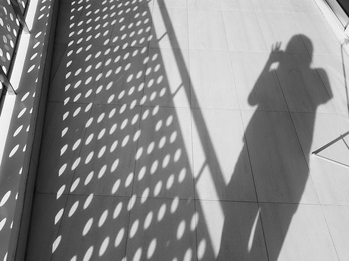 Shadow of man on tiled floor