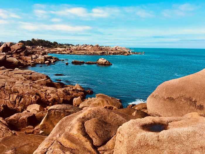 Pink granite coast Beauty In Nature Scenics - Nature Travel Destinations Tourism Turquoise Colored Horizon Over Water Horizon Sea Waterfront Water Travel Holiday Seascape Landscape Land Idyllic Côte De Granite Rose Pink Granite Coast Pink Color Rock Sunlight Sky And Clouds Blue Sky Solid Beach Nature Rock Formation Day No People