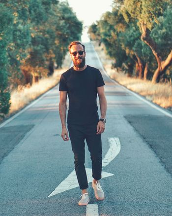 Sunglasses Full Length Road One Person Real People Casual Clothing Lifestyles Walking Front View Men Outdoors One Man Only Handsome Young Men Young Adult Leisure Activity Day Only Men Wireless Technology Adult An Eye For Travel