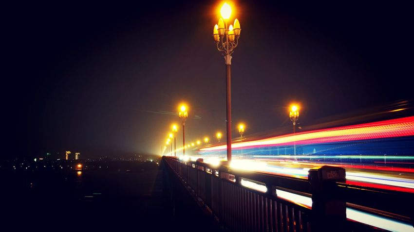 Illuminated Street Light Night Transportation Motion Speed On The Move Long Exposure Lighting Equipment Road Light Trail Bridge - Man Made Structure Blurred Motion City Life Mode Of Transport The Way Forward Outdoors Sky Tail Light Engineering