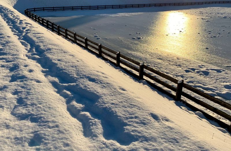 Scenic view of snow covered land during winter