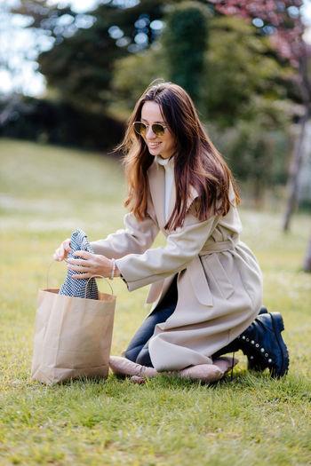 Woman wearing sunglasses on field