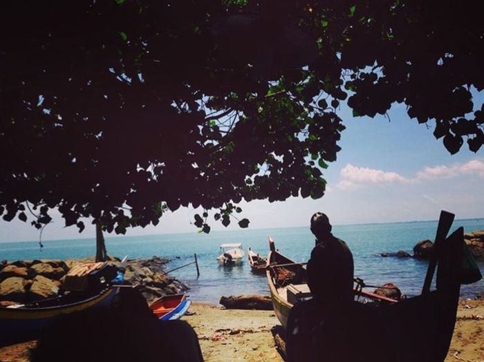 Beach Water Sea Beach Sitting Tree Land My Best Travel Photo Men Relaxation Nature Sky Day Real People Beauty In Nature Lifestyles Leisure Activity Sunlight Transportation Outdoors Adult Plant