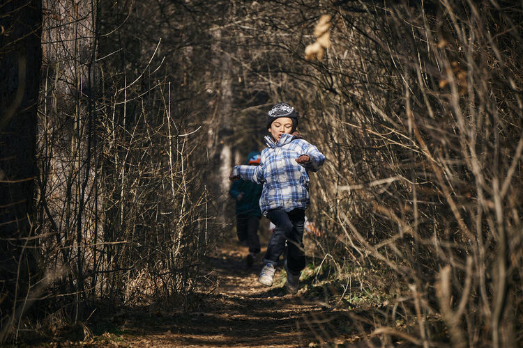 Hat Nature Running WoodLand Bare Tree Boys Casual Clothing Childhood Day Forest Front View Full Length Leisure Activity Outdoors This Is Family Capture Tomorrow