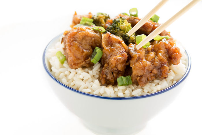 General Tso's Chicken and chopsticks Bowl Broccoli Chickens Chinese Food Chopsticks Cuisine Delicious Dinner General Tso's  Hot Springs Lunch Spicy Food Takeout White Rice