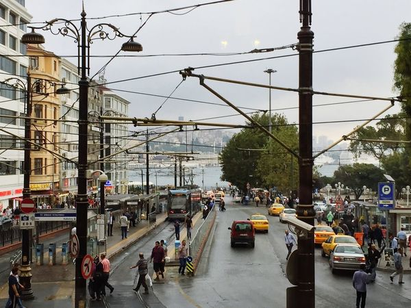 Istanbul's street Allianz Transportation Large Group Of People Land Vehicle Car City Mode Of Transport Mobility In Mega Cities Men Road Women Building Exterior Real People City Life Cable Public Transportation Railroad Track Day Street Outdoors Built Structure Architecture
