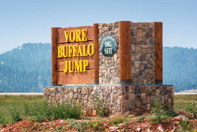 BEULAH, WY - AUGUST 26: Vore Buffalo Jump site in Beulah, WY on August 26, 2015 where thousands of buffaloes fell to their deaths Beulah Buffalo Jump No People Sign Signage Sky Travel Destinations USA Vore Buffalo Jump Wyoming