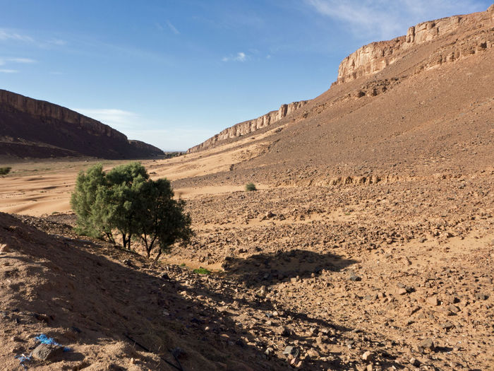 Trekking adventure in the desert Sahara in Morocco Tafraout Morocco Adventure Mountain Table Mountain Outdoors Formation Rock Formation Rock Sunlight Arid Climate Climate Desert Landscape Gravel Scree Valley Sahara Sand Wilderness Canyon Africa Rock - Object Mountain Range Tranquility