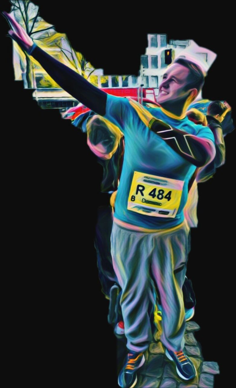 studio shot, black background, one man only, one person, multi colored, only men, human body part, adults only, adult, standing, athlete, sports clothing, portrait, sport, people, finish line, sportsman, young adult, day