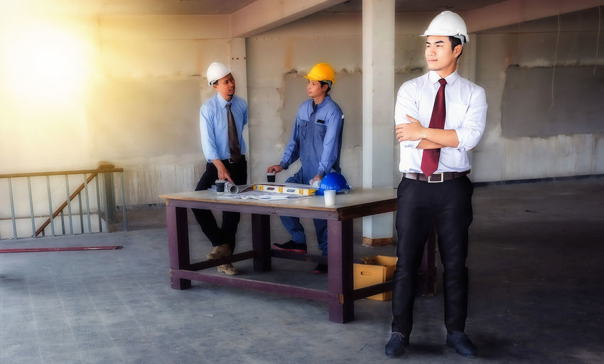Architect Standing At Construction Site