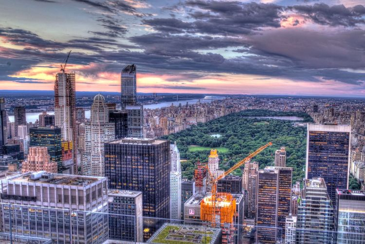 Sunset views over Central Park Architecture Cityscape Skyscraper Cloud - Sky Building Exterior Sky Built Structure City Dusk Sunset Illuminated Water Outdoors No People Urban Skyline Modern Night Nature Hdr_Collection Landscape Travel Destinations HDR
