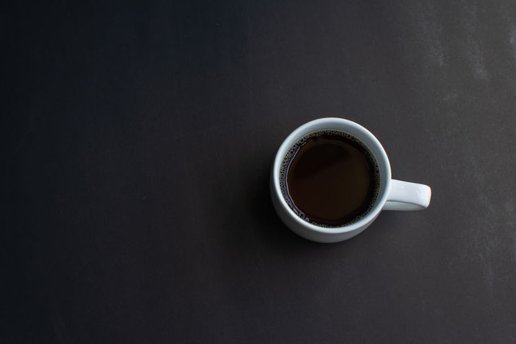 Cup Food And Drink Refreshment Drink Mug Coffee Coffee Cup Directly Above Indoors  Studio Shot Coffee - Drink Freshness Copy Space Table Close-up Still Life Black Background No People Black Color Hot Drink Crockery Non-alcoholic Beverage Tea Cup