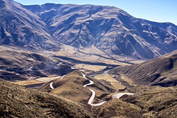 Argentina, Salta province, Cuesta del Obispo: the road that leads to the pass Andes Clear Sky Curves Geography Scenic Tranquility Travel Altitude Arid Climate Beauty In Nature Day Desolation Environment Eroded Idyllic Journey Mountain Range No People Nobody Outdoors Physical Geography Valley Winding Road
