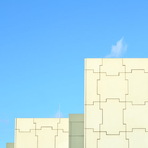 Low angle view of building against blue sky