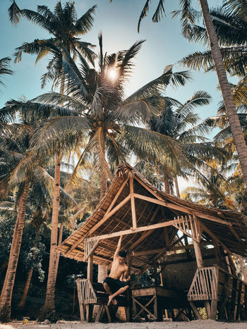 Travel Destination Tranquility Hanging By Bahay Kubo Under The Palm Tree Summer Time  Men Of EyeEm Sorsogon Province Philippine Beaches EyeEm Best Shots Architecture Built Structure Sky Plant