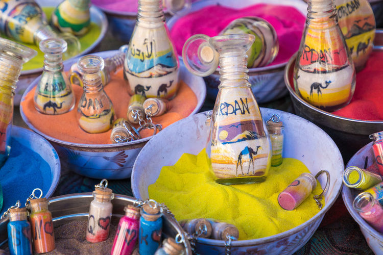 Close-up of multi colored bottles on display at market stall