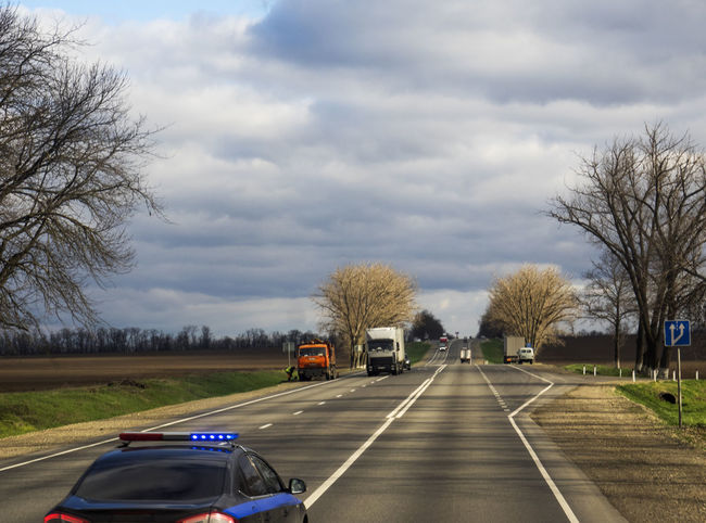 Russian route M29, Kropotkin, Russia Bare Tree Car City Life Cloud - Sky Cloudy Day Diminishing Perspective Land Vehicle M29 Mode Of Transport No People On The Move Outdoors Road Route Russian Sky The Way Forward Transportation Tree Truck
