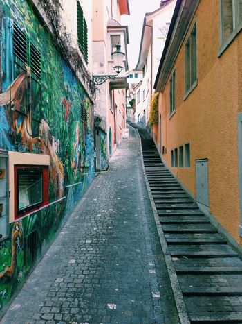 Architecture Building Exterior Built Structure City Life Composition Diminishing Perspective Graffiti Narrow Sidewalk Street Street Art The Way Forward Urban Walking Wall Painting Way Up Zürich