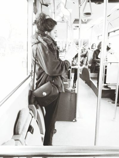 A casual end-of-fall-semester day in Paris, Latin quarter. Well known for its schools and universities, including the Sorbonne. Reminds me of when I was a student. Wouldn't bother to sit down while reading. Black And White Commuting First Eyeem Photo Reading A Book Bus Studying My Commute Handbag  Learn & Shoot: Working To A Brief Portrait Of A Woman Outfitoftheday Parisian Girl Follow Me Outfit Fashion Love Fashionista Paris  Parisianstyle Hairstyle Black Hair The Street Photographer - 2016 EyeEm Awards Up Close Street Photography Silhouettes Of A City Youth Of Today Parisian Chic Girl Power The Following Bnw_friday_eyeemchallenge London Lifestyle Focus Object Uniqueness EyeEmNewHere The City Light