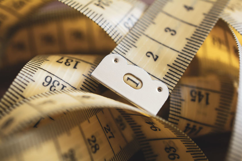 A Macro Of A Loose Messed Up Measuring Tape Flexible Measuring Tape Metric Soft Wood Centimeter Close-up Cm Macro Measure Measurement Meter Number Solid Table Tape Tool Toolkit Wood - Material Yellow