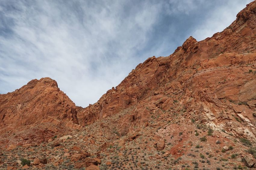 Low angle view of multi colored bare rock mountain EyeEm Selects Sky Cloud - Sky Scenics - Nature Nature Tranquil Scene Tranquility Beauty In Nature Mountain Day Landscape Mountain Range Desert Non-urban Scene Climate Arid Climate Environment Extreme Terrain No People Low Angle View Land