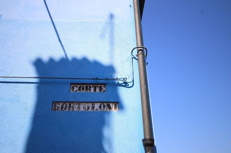 Burano Blue Blue Text Communication Day No People Outdoors Built Structure Architecture Clear Sky Building Exterior Close-up Buranoisland Italy Burano, Venice Colorful Venezia First Eyeem Photo