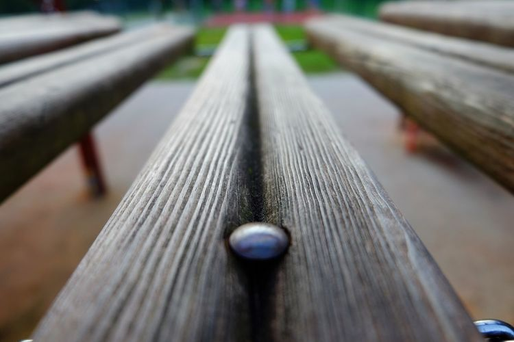 Close-Up Of Wooden Surface Level Of Railing