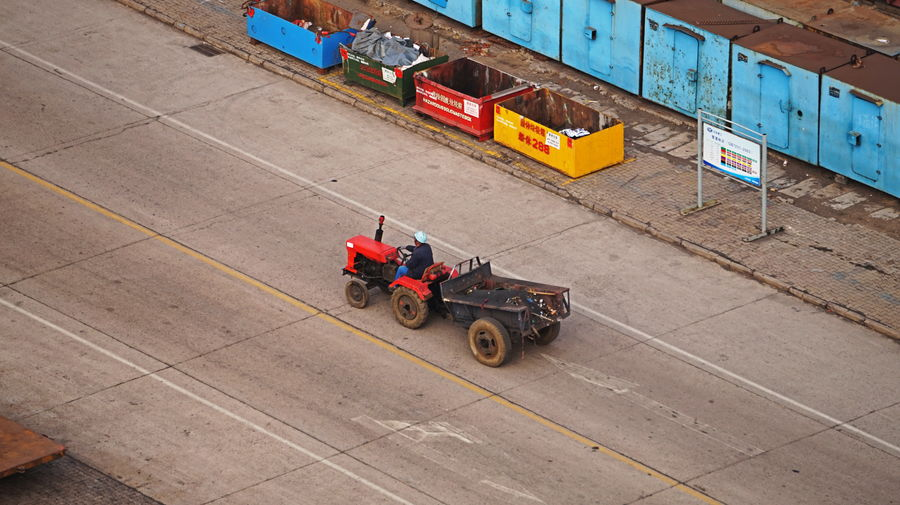 High angle view of man driving tractor on road