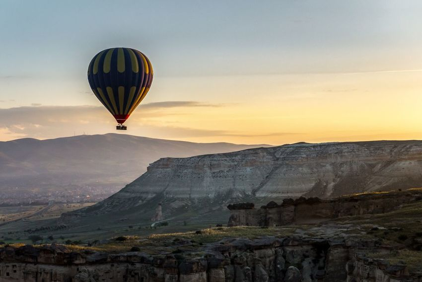 Sunrise Mountain Cappadocia Nature Flying Sky Landscape Travel Day Outdoors Hot Air Balloon Rock Formation Nature Beauty In Nature Mid-air Scenics Rock - Object Adventure Transportation Turkey Air Vehicle Mountain Range Journey Vacations Beauty In Nature