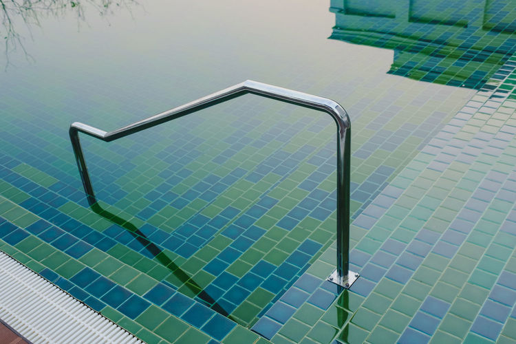 High angle view of metallic floor by swimming pool