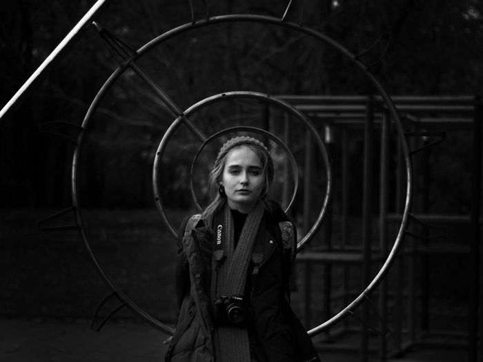 Portrait Of Woman Amidst Circular Metals