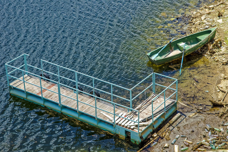 EyeEmNewHere Floating Bridge Romania Beach Boat Day High Angle View Landscape Metal Mode Of Transportation Nature No People Outdoors Railing Reflection Staircase Tranquility Transportation Water