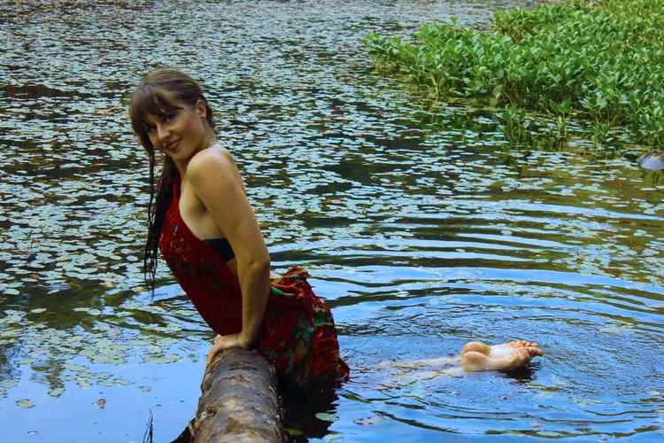 Portrait of happy woman in lake