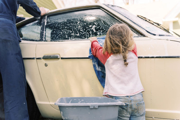 Rear view of women standing in car
