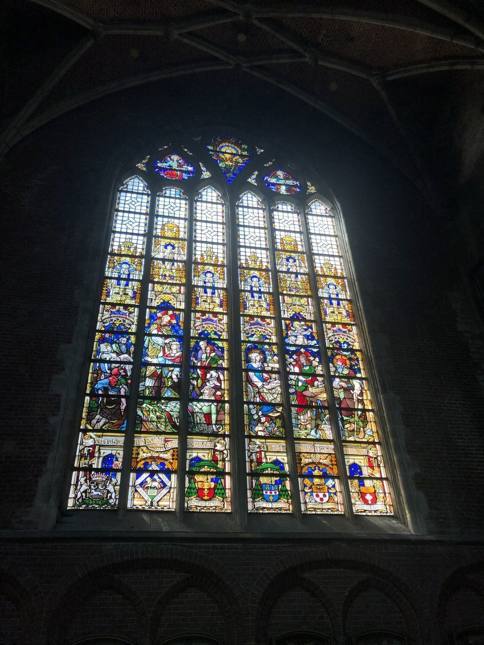 stained glass, place of worship, religion, belief, window, glass, architecture, spirituality, built structure, low angle view, glass - material, indoors, multi colored, building, no people, arch, ceiling, ornate