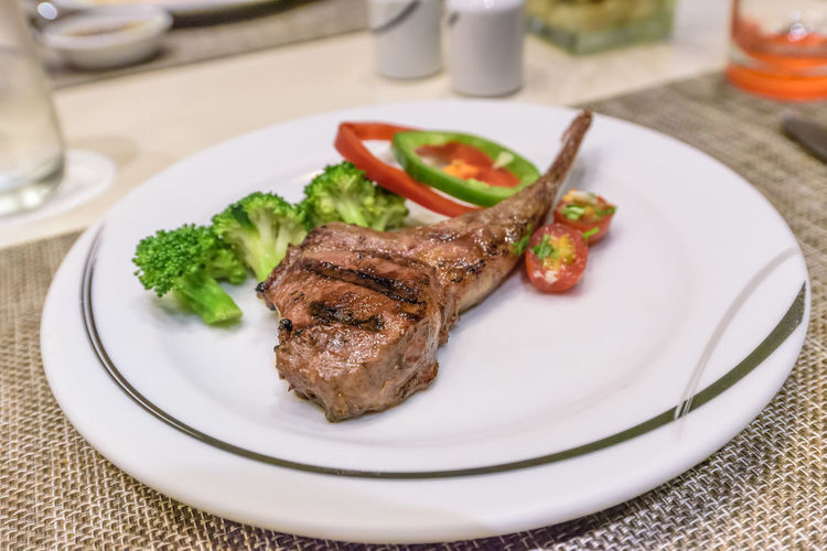 Lamb Rack Steak Recipe on white plate Food And Drink Food Freshness Indoors  Healthy Eating Close-up Wellbeing No People Table Dish Place Mat Meat Plate Ready-to-eat Steak Dinner Beef Red Meat Vegetable Serving Size Restuarant Grill Barbecue Grill Cuisine Health