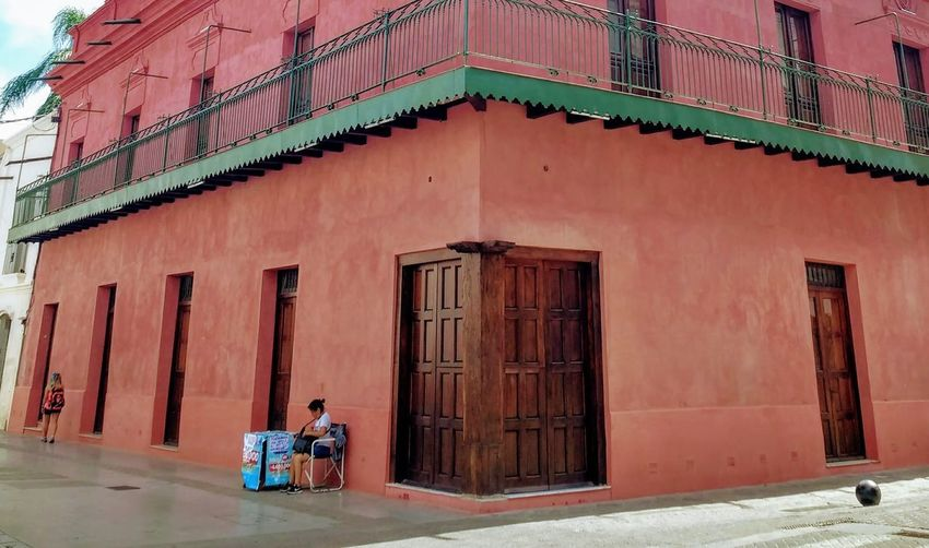 Architecture Building Exterior Real People Building Day City Sitting Street Two People Balcony Colonial Architecture Colonial Style Corner Wood Door