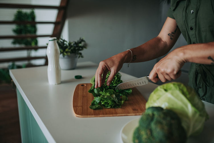 Midsection of man preparing food on table at home